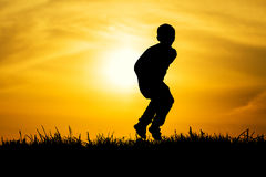 silhouette-jumped-boy-sunset-background-41488310